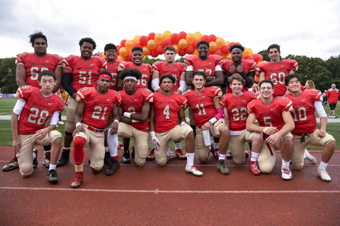 Hills West senior football players pose before last week's homecoming game.