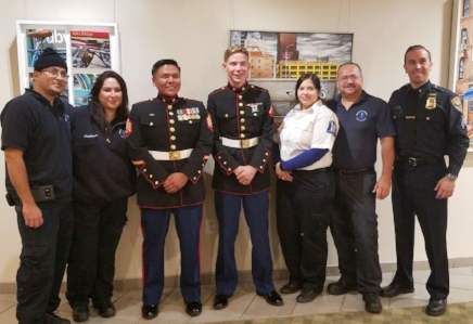 Members of the Huntington Community First Aid Squad stand with USMC Sergeant Jeff Silentwalker, USMC Lance-Corporal Joseph Kaye and Auxiliary Police Sergeant Douglas Henningsen.