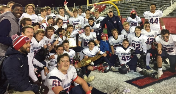 The Cold Spring Harbor Seahawks celebrate their Long Island Class IV title after defeating Shoreham-Wading River 42-20 at Stony Brook University on Nov. 23.