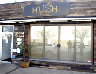 Paper in the windows of Hush Bistro on Gerard Street in Huntington village signaled the restaurant is closed.
