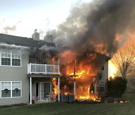 A raging fire consumes two condos at The Greens in Melville.  Photo/Melville FD