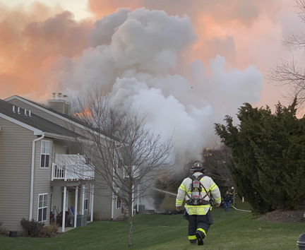 Smoke fills the afternoon sky as firefighters battle a blaze at The Greens in Melville,  Photo/Melville FD