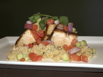 """Seared wild salmon ($17.99) on a cauliflower """"couscous"""" dressed with mint, tomato, red onion, cucumber, and lemon vinaigrette."""