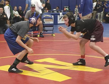 Wildcat wrestlers practice their moves.