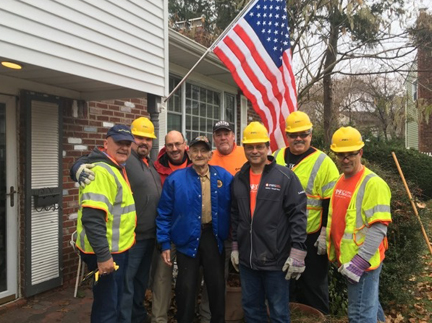 Volunteers from PSEG Long Island and Moonjumpers helped WWII veteran Morris Koffer clean up his home and yard.  Moonjumpers photo