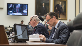 Congressman Thomas Suozzi works during a hearing of the House Committee on Ways and Means.