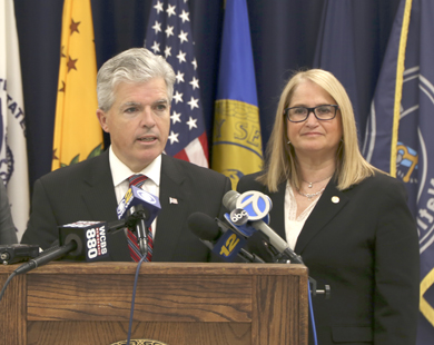 Suffolk County Executive Steve Bellone signed Legislator Susan Berland's legislation requiring amusement parks and water park operators immediately report criminal conduct on their property.