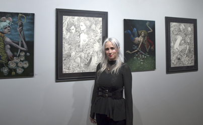 Haven Gallery owner and curator Erica Berkowitz shows and sells art depicting fantasy.  Long Islander News photo/Sophia Ricco