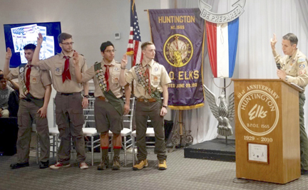 Joshua Kimmelstein, Thomas Kowalski, Tristan Delaney and Dylan Campbell take the pledge as they are inducted into the elite ranks of Eagle Scouts by Boy Scouts of America Suffolk County Council VP David Hunt.