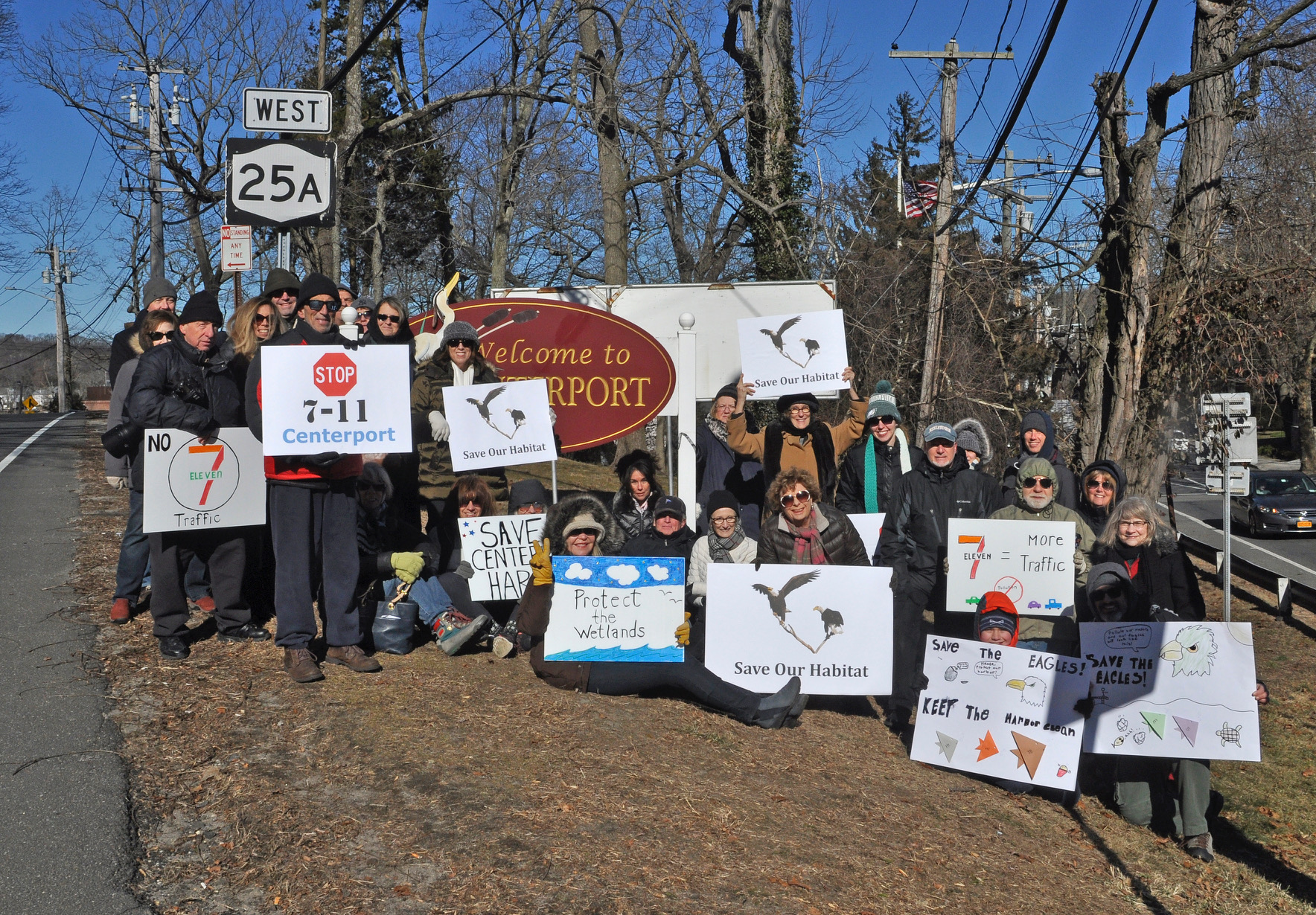 Members of the Centerport Harbor Civic Association rally on Route 25A in Centerport Saturday to urge town officials to protect the habitat of bald eagles living near Mill Pond.   Photo/Centerport Harbor Civic Association