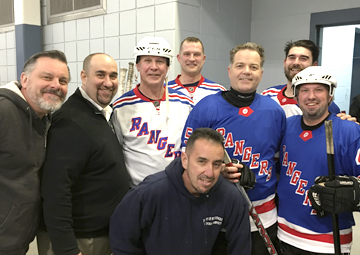 At a charity hockey to benefit youth hockey are, from left, back row: rink maintenance worker Jerry Reikert; rink manager Matt Naples; Rangers Brian Mullen and Colton Orr; Huntington Councilman Ed Smyth; skating instructor James Chang; assistant rink manager Kevin Young and Mike Graziano.