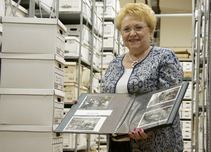 Town Clerk Jo-Ann Raia will retire at the end of the year after 38 years in office. Raia, pictured in the Town Records Center and Archives, counts the preservation of important town documents and artifacts archived there as one of her greatest accomplishments.
