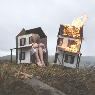 A child's dollhouse sawed in two creates the basis of this image.  Photo/Nicolas Bruno