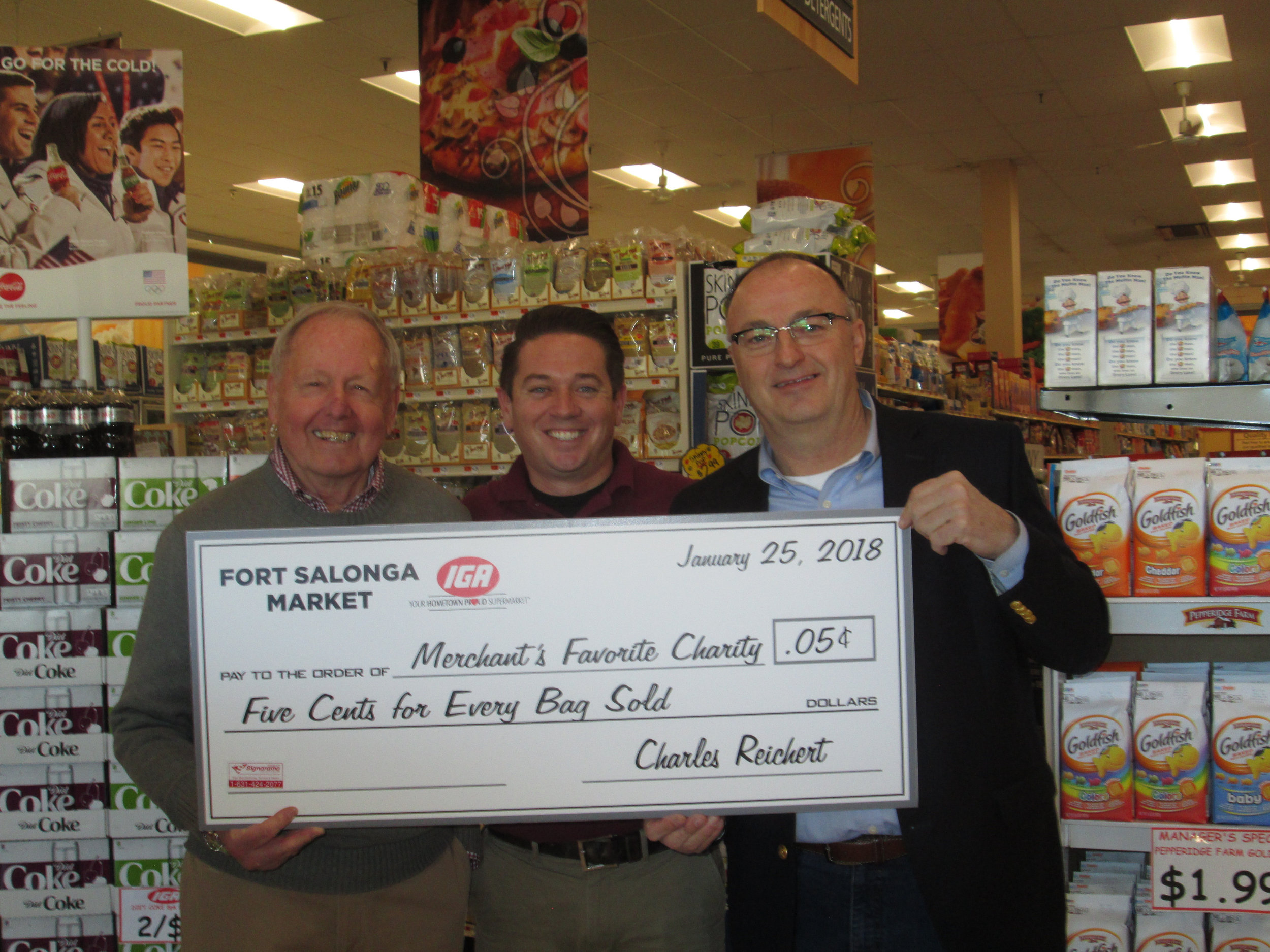 IGA owner Charlie Reichert, left, Suffolk Legislator Robert Trotta, right, and Fort Salonga IGA's manager Ryan Ceriello pictured last year when Reichert announced he would donate the store's plastic bag fees to Huntington Hospital.