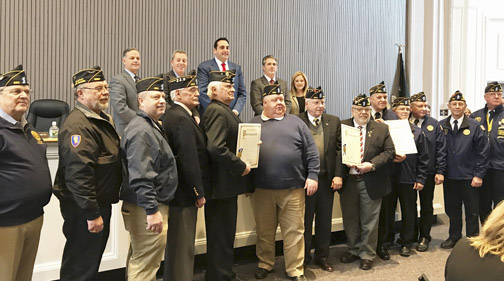Members of American Legion Greenlawn Post 1244, Huntington Post 360 and Northport Post 694 receive proclamations at Tuesday's town board meeting in recognition of the national organization's 100th anniversary.  Photo/Town of Huntington