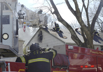 A ladder truck from Commack Fire Department gets into position at the scene of a house fire and explosion on Ripley Drive in Northport.  Long islander News photos/Sophia Ricco