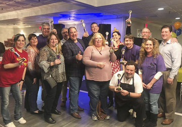 Winners of last years Nick Demidovich Chili Cook Off celebrate at the Huntington Elks Club. This years cook off is set for March 31.