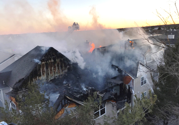 Firefighters in Melville battle a blaze at the Avalon Court complex that took over 120 firefighters from 12 departments to put out.  Photo/Melville FD