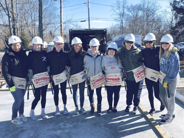 Students from Elwood John Glenn High School on the job helping to build a Habitat for Humanity home.