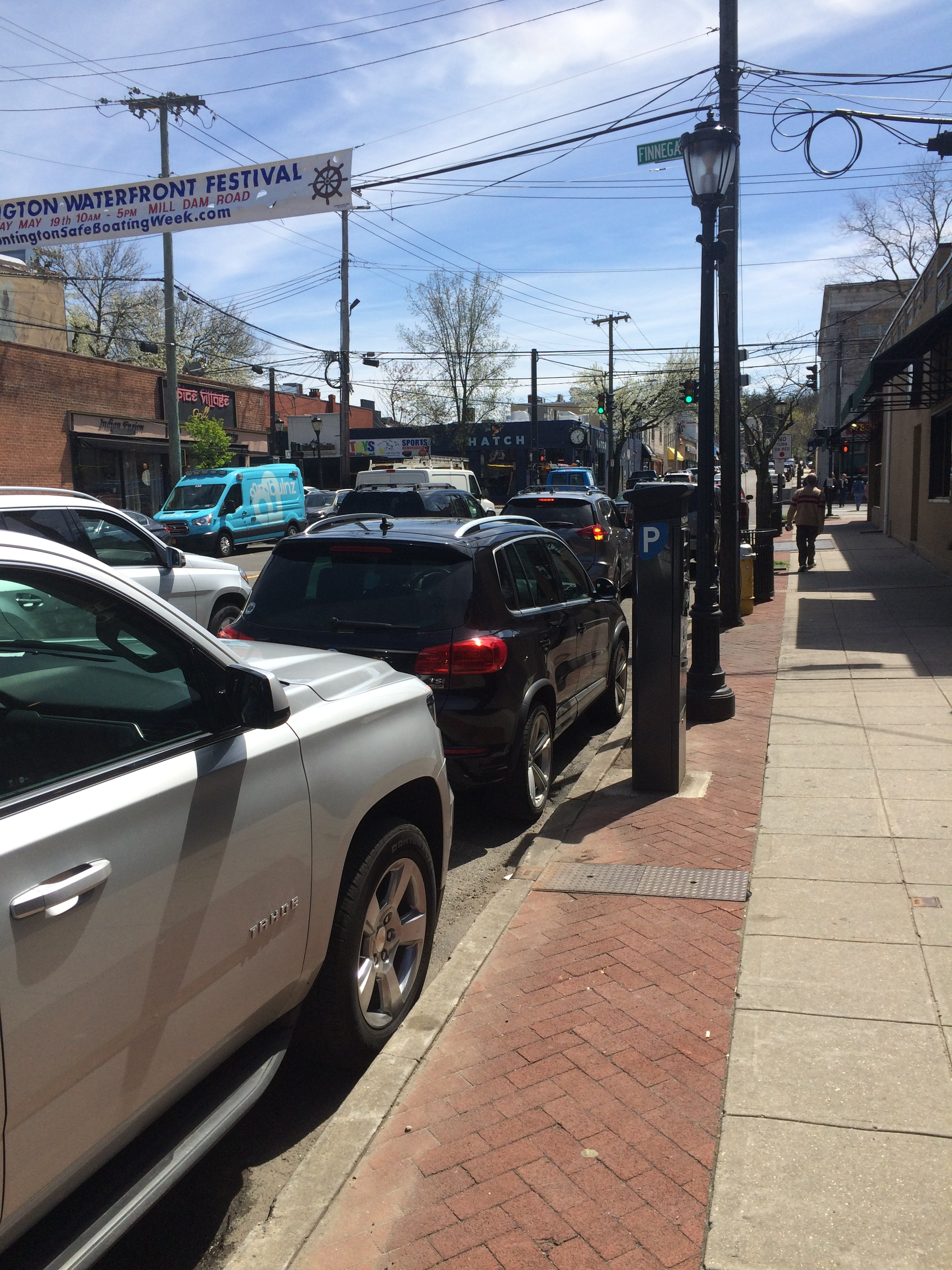 Cars parked on Wall Street near the intersection with Main Street in Huntington village. The town board voted Tuesday to increase parking fees on side streets in the village.  Long Islander News photo/Connor Beach