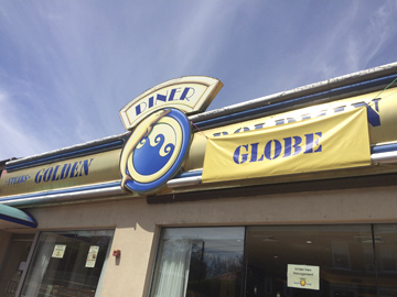 A banner on the sign of the former Golden Dolphin Diner in Huntington shows the diner's name has been changed to the Golden Globe.