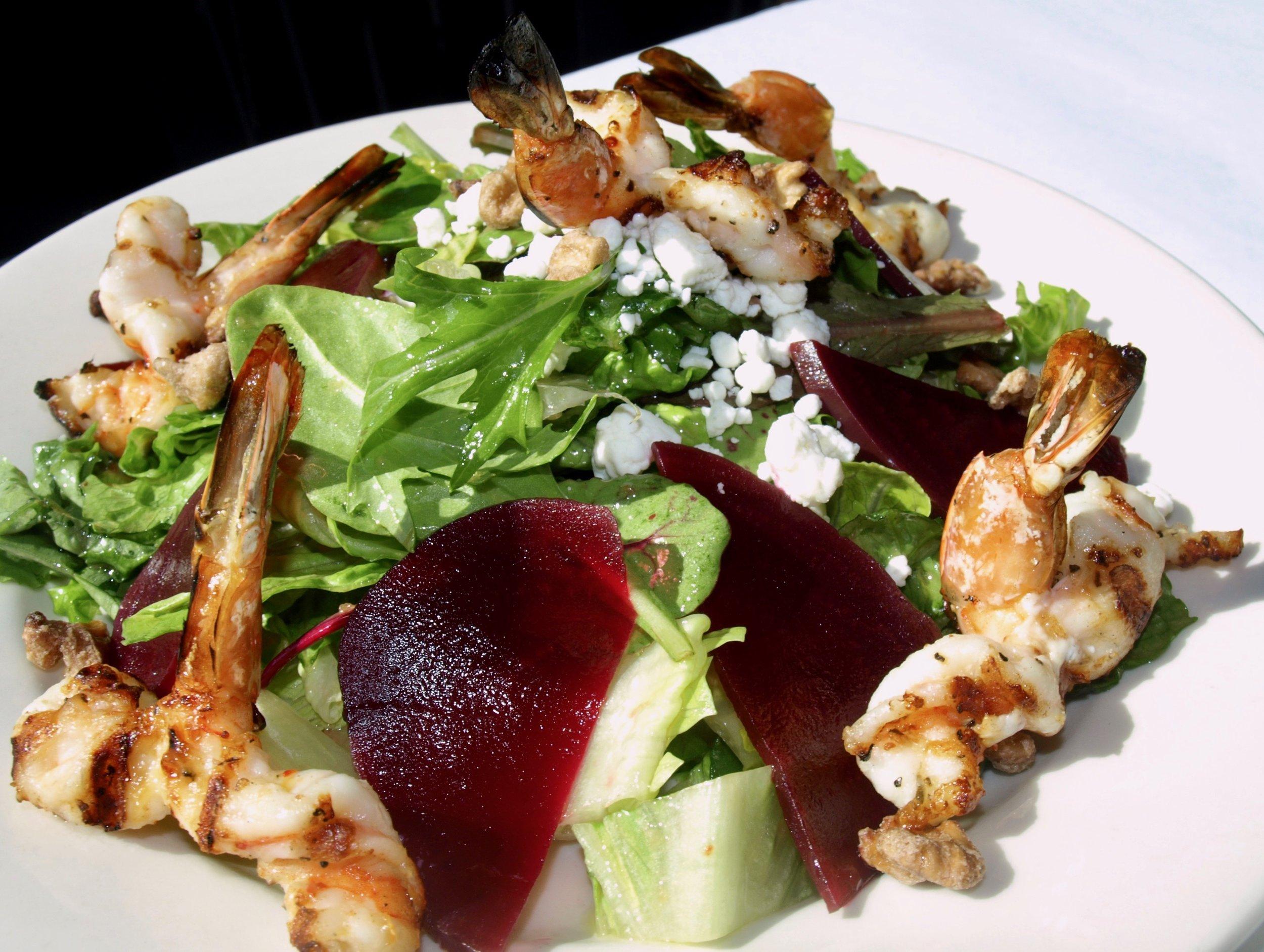 Beet salad of mixed greens, goat cheese, walnuts and balsamic dressing