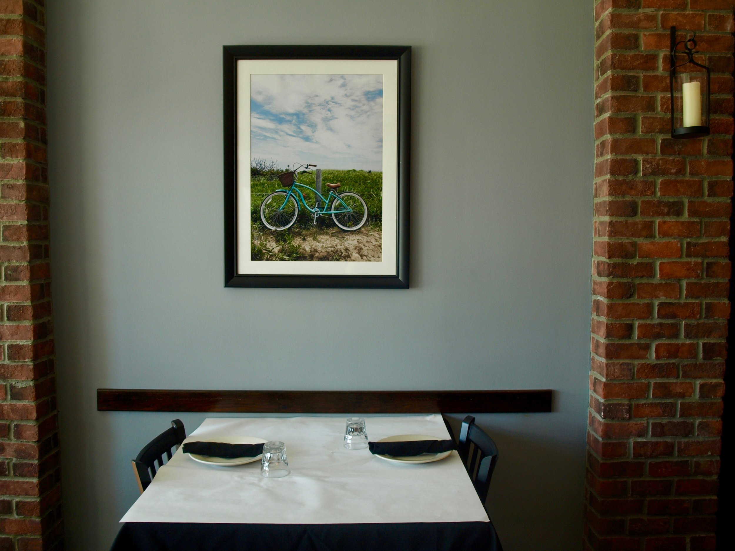 Eatalia's interior features photographs taken by a member of the Salese family.