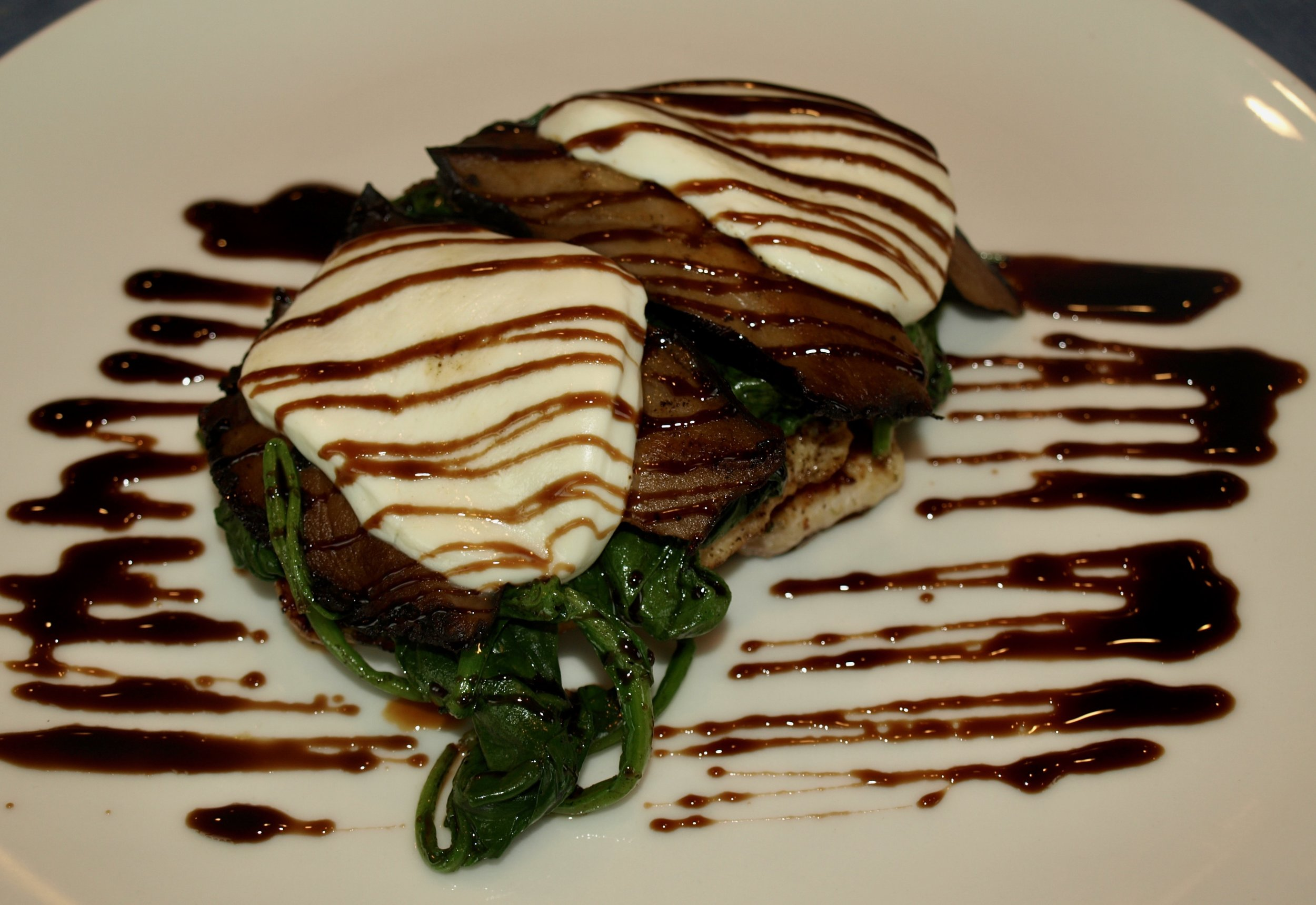 Grilled chicken balsamico topped with sauteed spinach, Portobello mushrooms and fresh mozzarella, drizzled with a balsamic reduction