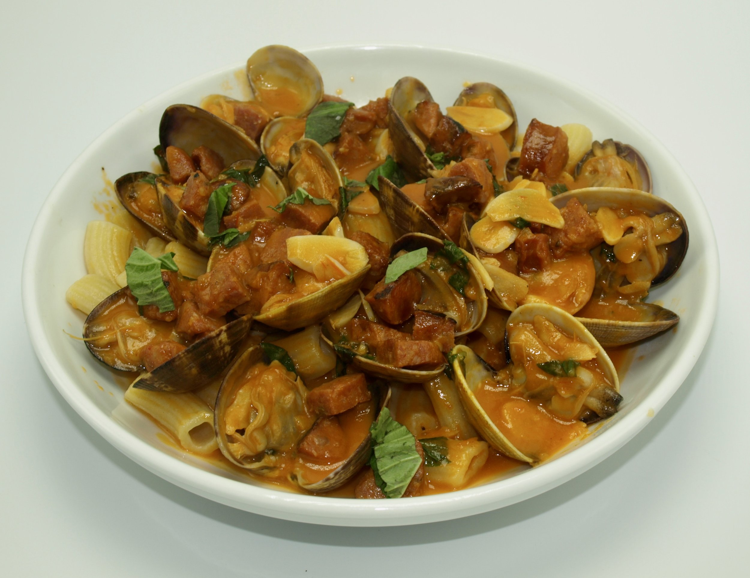Some Foodie favorites from Piccolo Mondo include: Rigatoni with Manila clams, chorizo and tomato-basil brodetto.