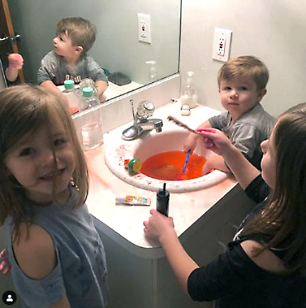 The original picture that captured Clorox's attention of the Madden kids playing with a bath bomb in the bathroom sink.