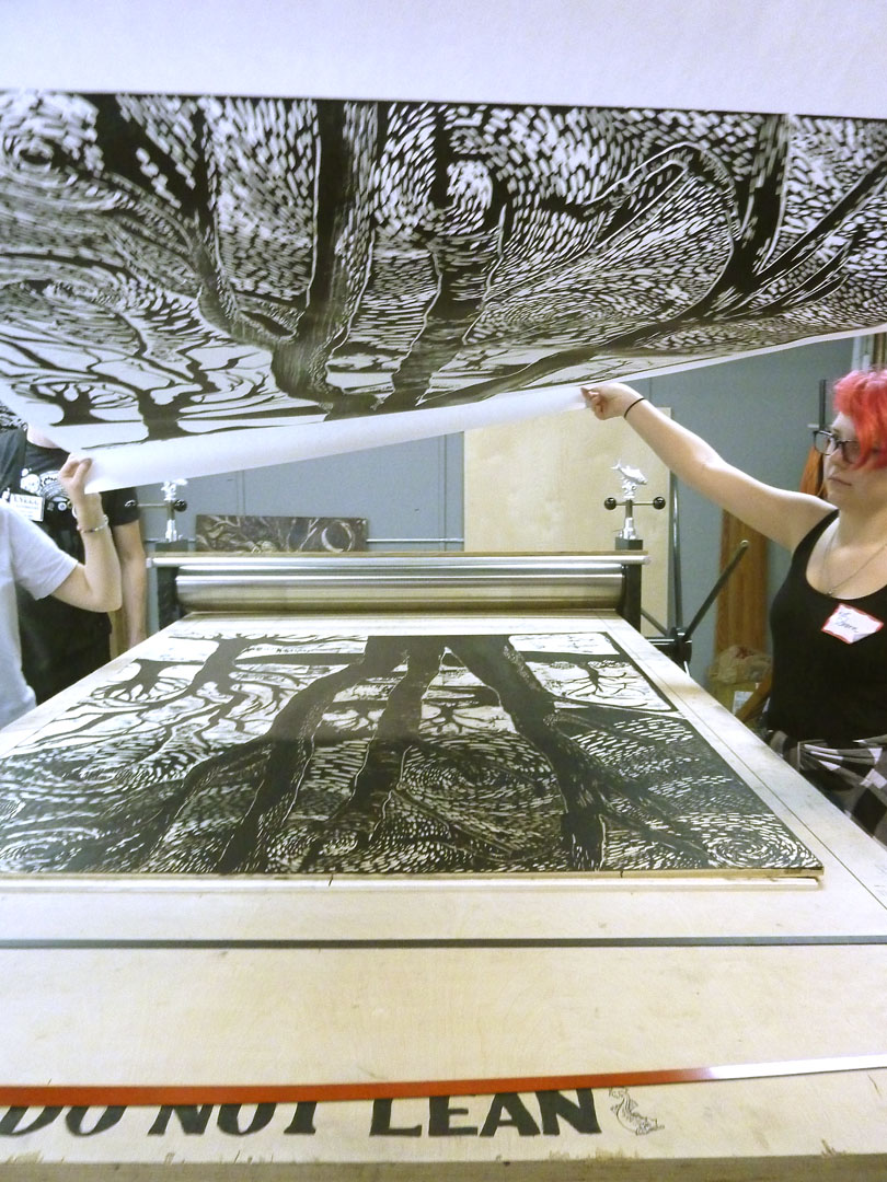 Kat Shorn gets a first look of the print coming off the press.