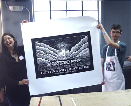 Jen and Theo Lau show her fresh-off-the-press print of Huntington Lighthouse.
