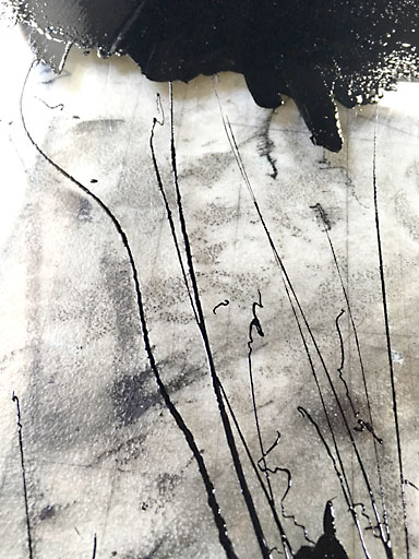 Ink dribbles and brayer marks give Lyle's work area the feel of an abstract piece.