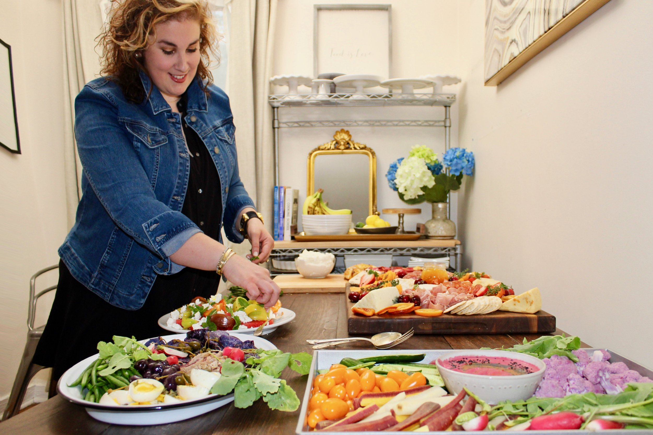 Personal chef Nicole Uliano putting the finishing touches on a spread. Her presentations' bold contrasting colors have eye appeal, and fresh ingredients and flavor combinations take care of the rest.