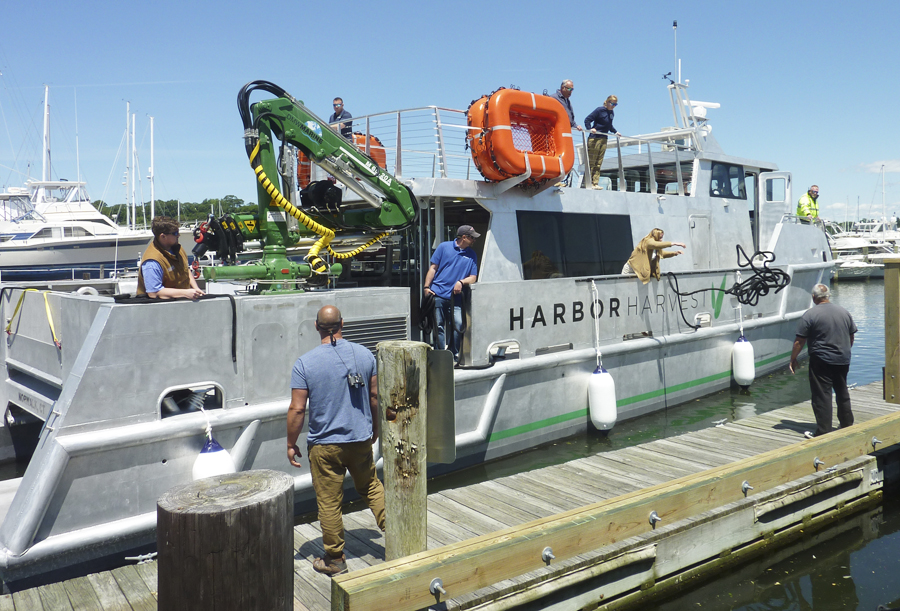 A 65-foot customized catamaran that will soon ferry goods between Long island and Connecticut made its maiden voyage to Huntington last week.  Long Islander News photo/Peter Sloggatt  (