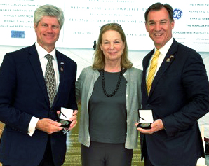 Rep. Tom Suozzi, right, and Rep. Jeff Fortenberry, left, met with Susan Eisenhower who presented the congressmen with medals recognizing their efforts to promote the history of the Normandy invasion.