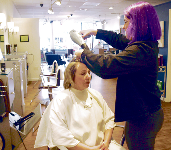 "Stylist Colleen Moran completes a ""curly cut"" that has clients wear their curls naturally for two customized cuts.  Long islander News photos/Sophia Ricco"