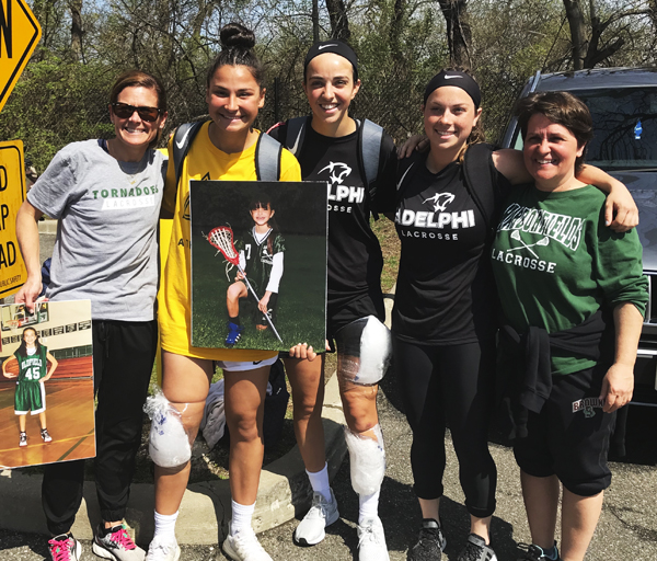 "The three Harborfields players who helped Adelphi's Lady Panthers to an NCAA Div. II title with their former high school coaches on ""Senior Day"" back in April. From left are Coach Kerri McGinty, Gianna Bifulco, Chelsea Abreu, Kailey Broderick, and Coach Mary Santomauro."