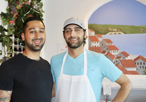 Owner Edmund Zarou, left, has kept Zaro's Cafe a family tradition taking over the business after 25 years. Cousin Alex Solounias is the restaurant's chef and grillmaster.