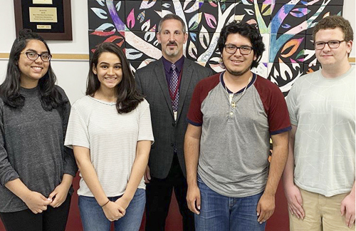 "Students Umema Siddiqui Alina Naseer Efrain Citle-Palestino and Benjamin Joseph were recognized by NPR radio's Student Podcast Challenge for their submission ""Between Two Worlds."""