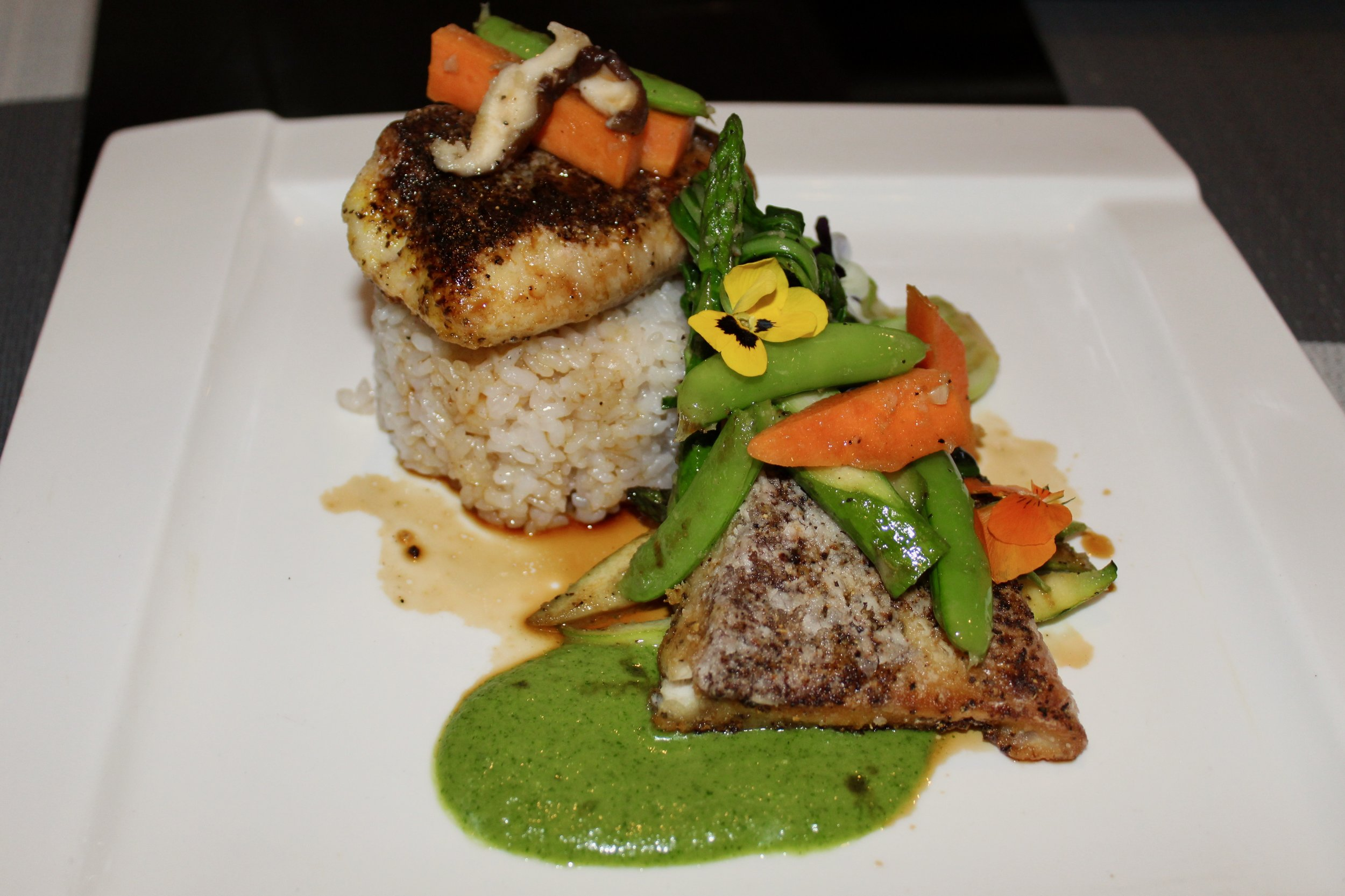 Pan-seared Wild Striped Bass with coconut rice, asparagus and jalapeno miso.