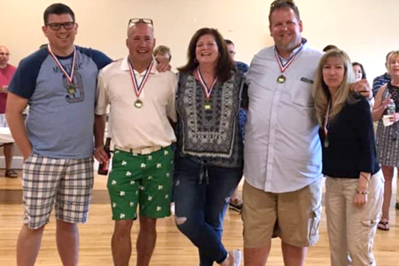 Winners of the inaugural Gerard Molloy Chili Cook-Off sponsored by Huntington Ancient Order of Hibernians, from left, are: Brian Rogers, Steve Fox, Deb Stolba, Bryan Kelly and Elaine Dougherty. The event honored the memory of Hibernian Gerard Molloy, inset at right, who died earlier this year.