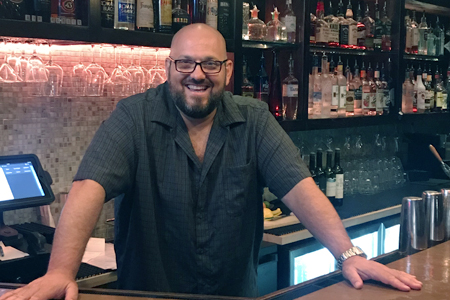 John Conzone mans the bar at Bar Petite in Huntington.