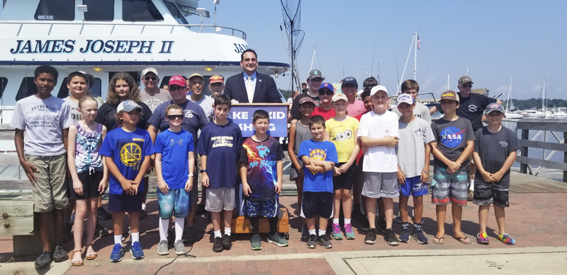 "Winners of the ""Take a Kid Fishing"" trip with Huntington Supervisor Chad Lupinacci, James Joseph II captain James Schneider; Jim Howard and Jerry Giuseppone of the Suffolk County Senior Citizens Fishing Club; and John Schoenig and Bob Gordon of the Imperial Sportsmen's Club of Long Island, ready to embark on a four-hour fishing excursion."