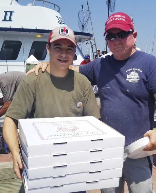 James Joseph Captain James Schneider, right, with Di Raimo's Pizza's delivery guy. Resident Paul Travaglia arranged for Di Raimo's to deliver hot pies to the boat so there was pizza for all.
