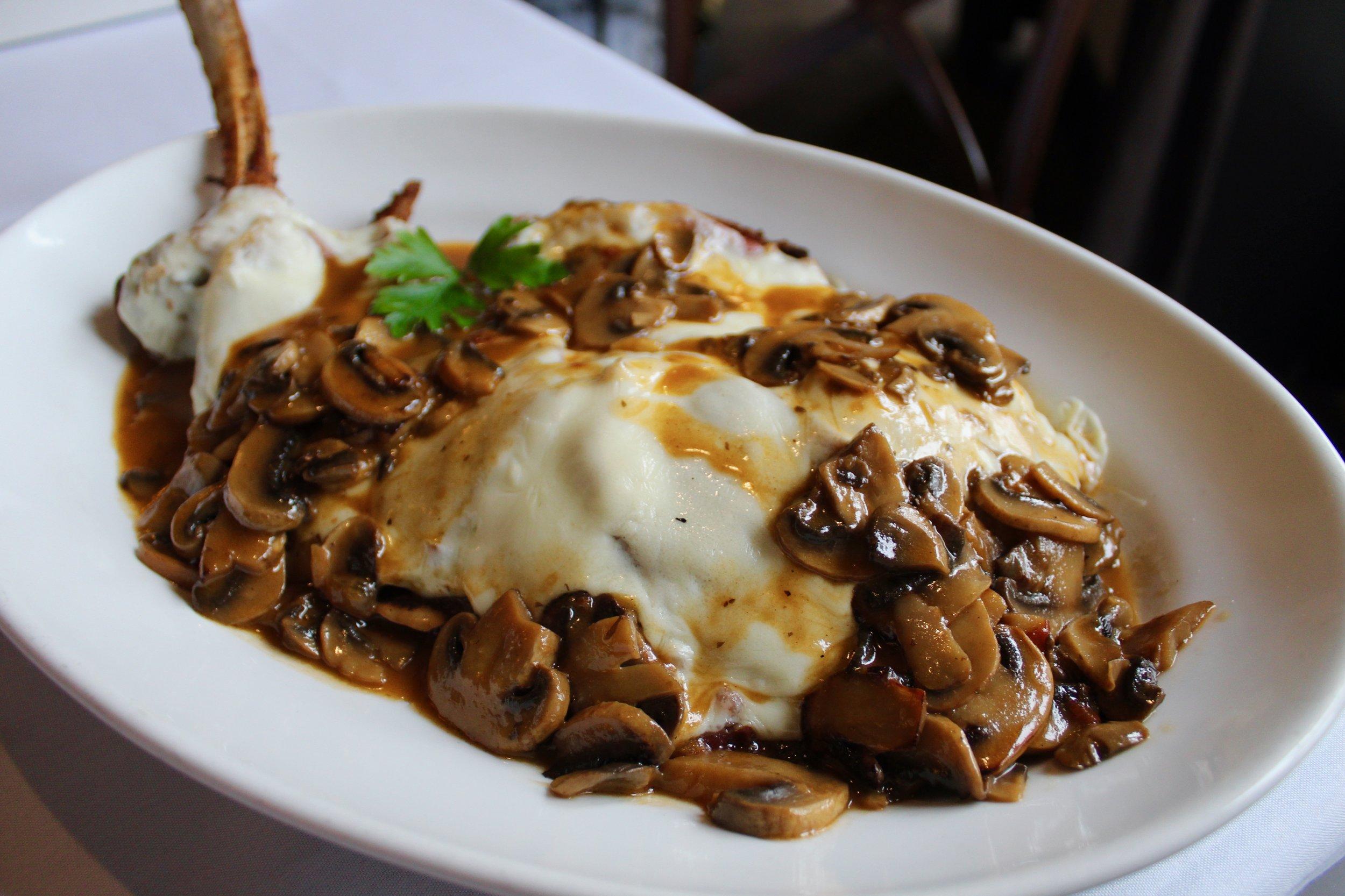 Veal Chop Valdostana with mozzarella, prosciutto, mushroom, marsala.