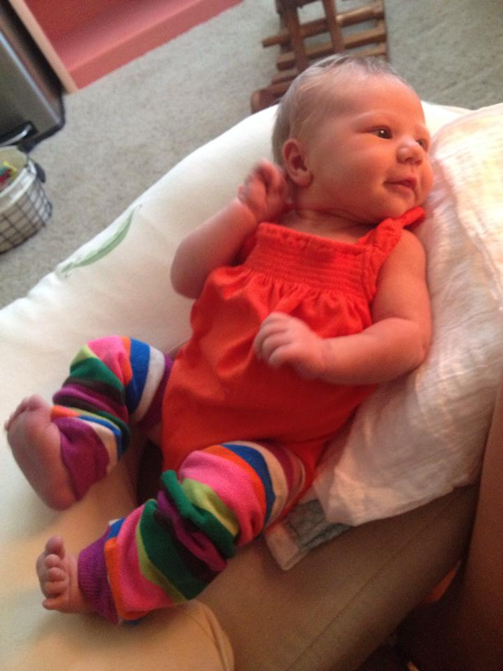 """Pretty much my favorite picture ever. She's totally posing and turning to """"find her light"""" so she can show off her first pair of baby legs. {Seven days old}"""