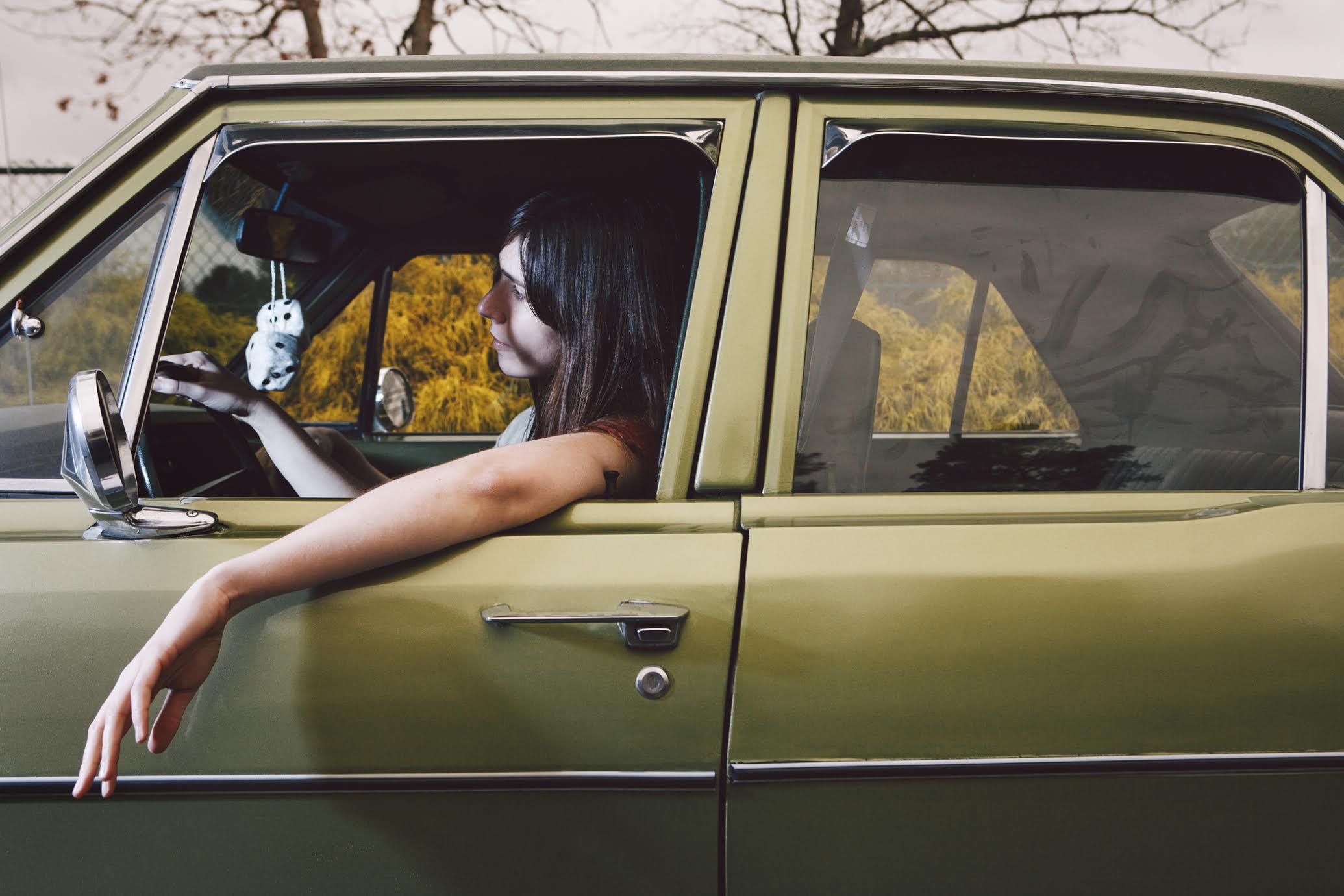 NADINE GIRL IN CAR.jpg