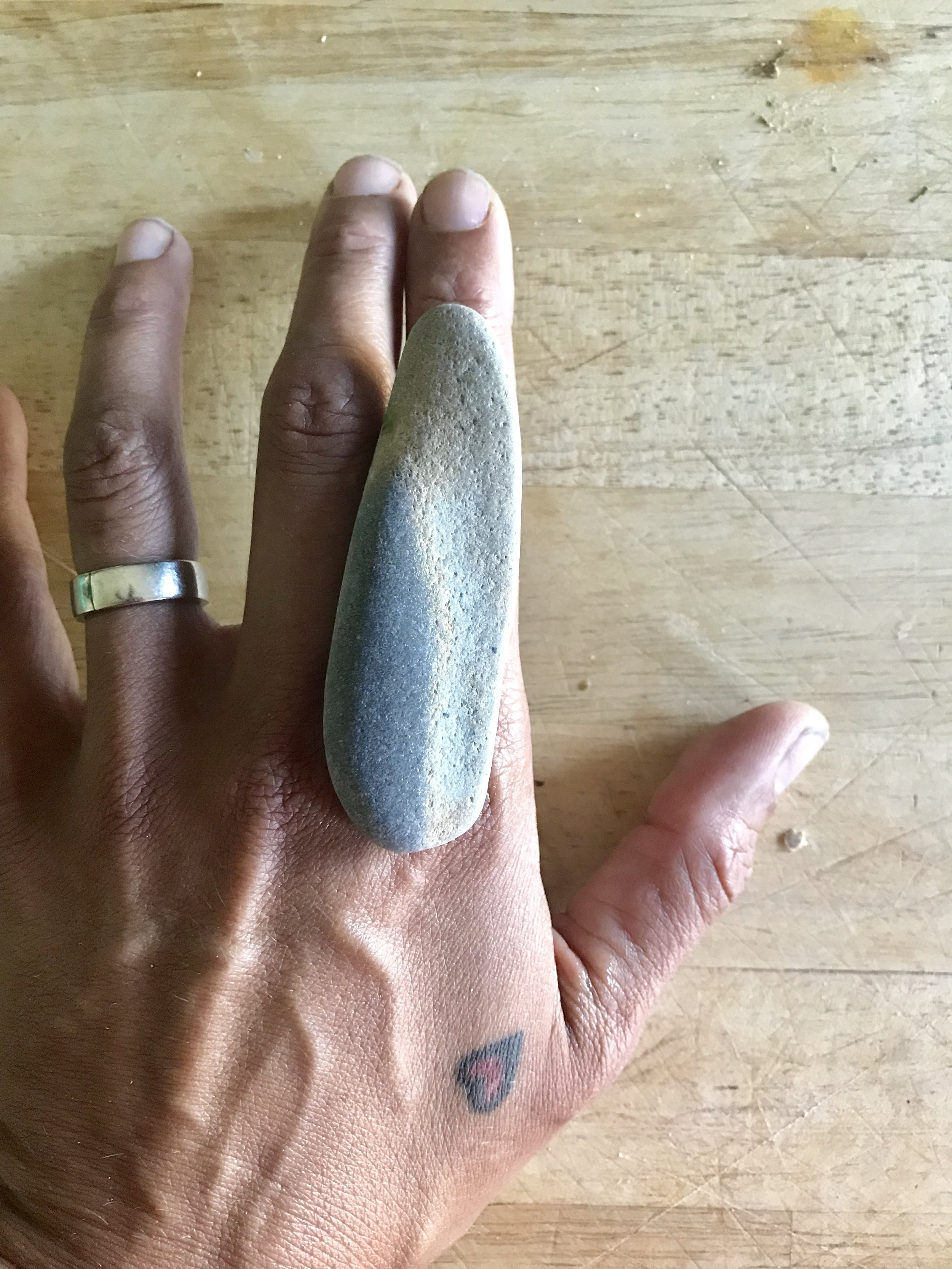 maine beach stone ring other side on hand