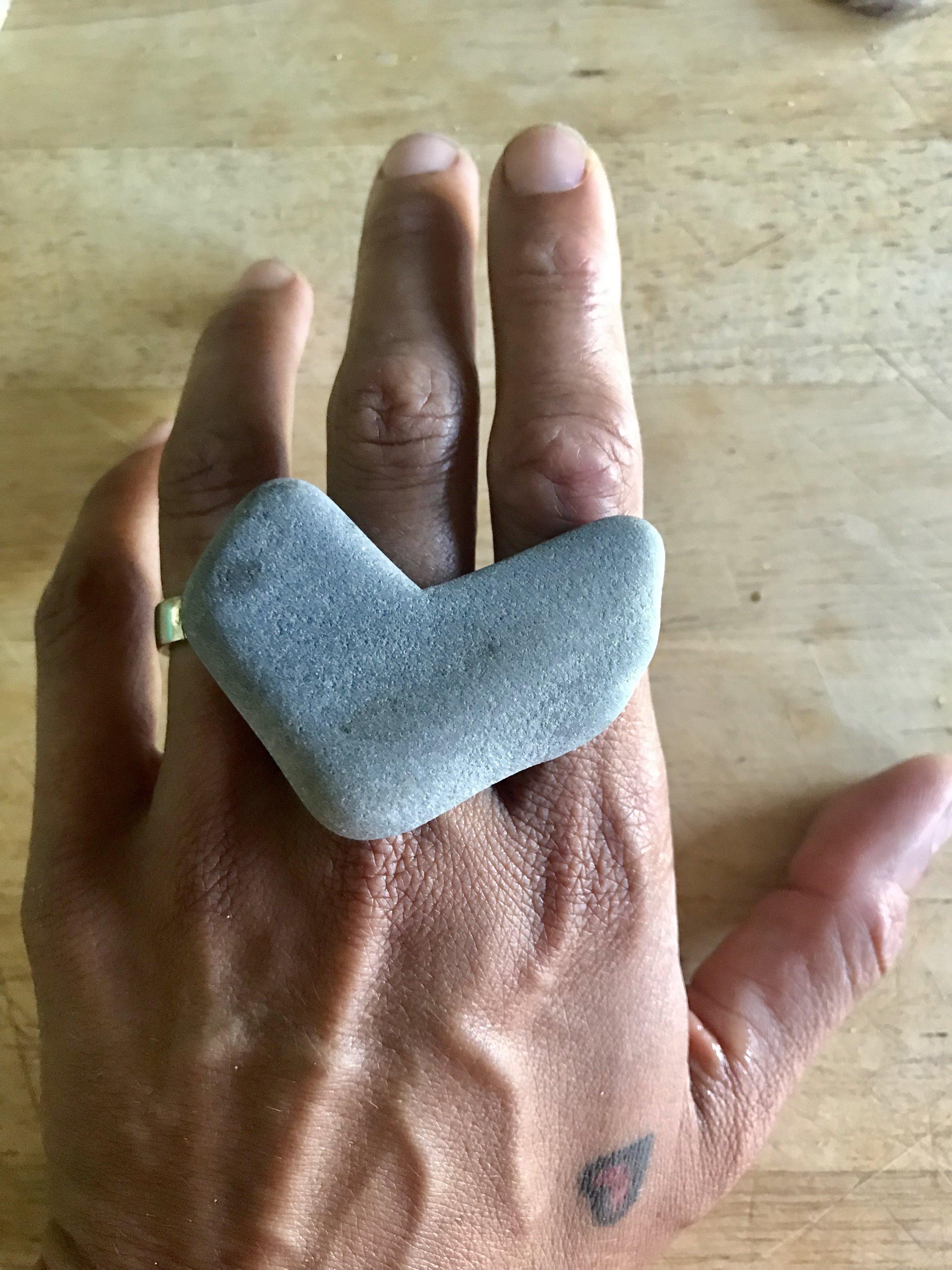 maine beach stone heart on hand